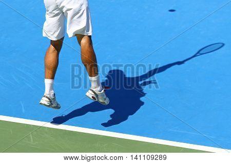 Tennis Player Serves The Ball