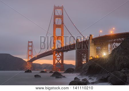 Marshall Beach Golden Gate National Recreation Area, San Francisco, California, USA Lights and Fog on the world's ninth longest suspension bridge.