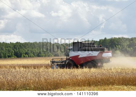 NARO-FOMINSK RUSSIA - JUL 31 2016: Harvesting of wheat. Combine Harvester in agricultural fields. Russia ranks first in the export of wheat in the world is continuously increasing the grain production