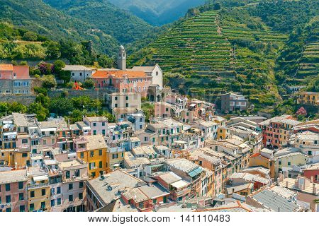 Church, Monastery of St. Francis, colorful facades of the old houses in the village Vernazza. Cinque Terre National Park, Liguria, Italy.