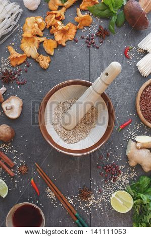 Asian still life. Japanese mortar ( suribachi and surikogi)  and some of ingredients for cooking, top view