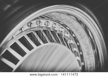 Close-up Of Aluminium Rim Of Luxury Car Wheel, Black And White