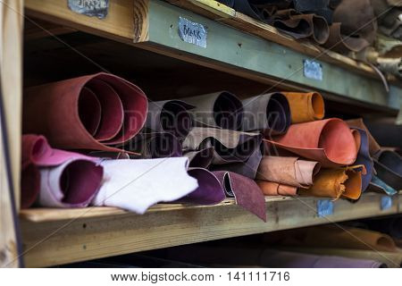 High quality multicolored dyed leather on shelves.