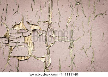 old texture of a peeling of the wooden board painted in the pale color for abstract background