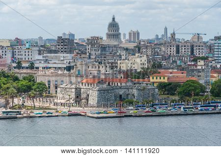 HAVANA, CUBA - APRIL 1, 2016: View of the Capitolio and surroundings from the other side of the bay in Havana Cuba