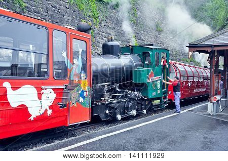 Brienz, Switzerland - June 12, 2010: Retro train with locomotive crew before departure. Brienz-Rothorn bahn is cogwheel narrow gauge railway with beautiful mountain views.