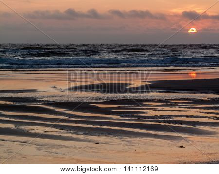 Cape Lookout sunset from the beach at high tide Oregon USA