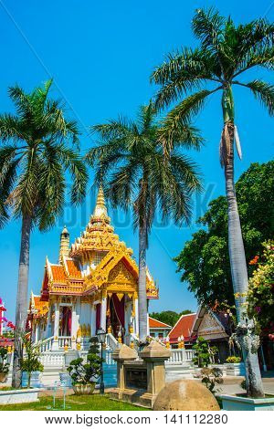 Buddhistic Temple.palm Trees On Blue Sky Background. Ayutthaya. Thailand.