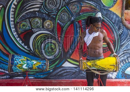 HAVANA CUBA - JULY 18 : Cuban Rumba drummer in Havana Cuba on July 18 2016. Rumba is a secular genre of Cuban music involving dance percussion and song. It originated in the northern regions of Cuba