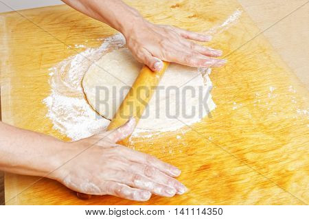 Housewife Rolls Dough For The Pie
