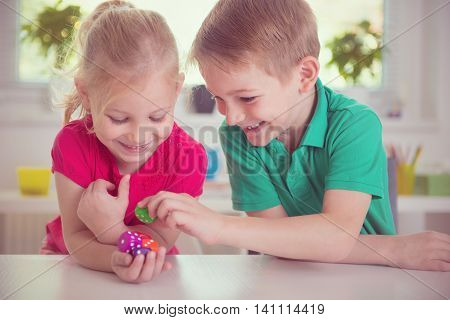 Two Happy Children Playing With Dices