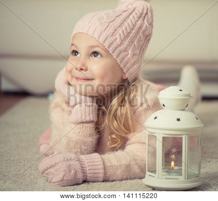 Portrait Of Cute Girl In Hat And Gloves At Christmas Time