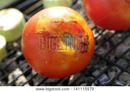 Tomato on the grill grate on picnic