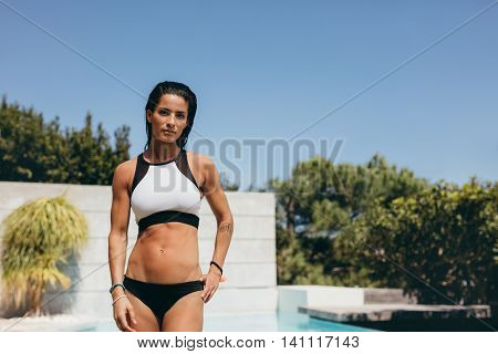 Confident Woman In Swimwear Standing At The Poolside