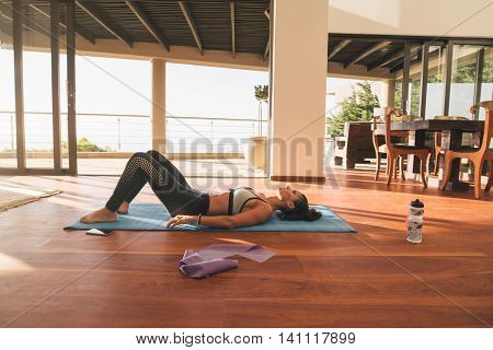 Female Relaxing On Floor After Workout