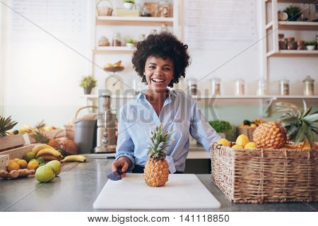 Cheerful Young African Woman Working At Juice Bar