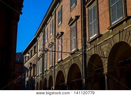 Typical italian facade in a street of Bologna at sunset. Emilia-Romagna. Italy.