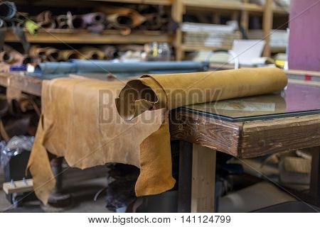 Outstretched leather awaits bookbinder for cutting and dye.