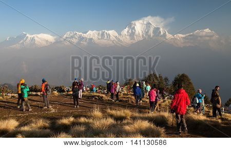 POON HILL NEPAL 8th APRIL 2016 - morning view of Poon hill with tourists and panoramic view of mount Dhaulagiri. Poon hill is one of the best view points to Dhaulagiri and Annapurna.