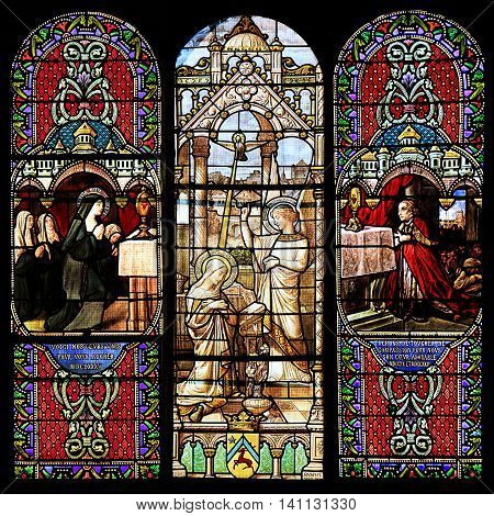 MACON, FRANCE - January 13 2015: Stained glass window illustrated Bible stories in the Cathedral of Macon Borgogne France