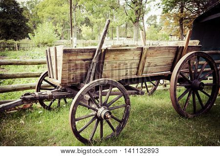 Old horse drawn wooden cart  Europe .