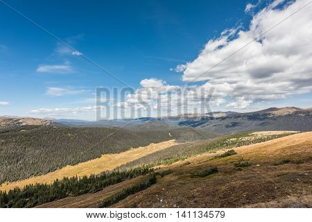 Overlook of Rocky Mountains with plains and pine forest in Colorado