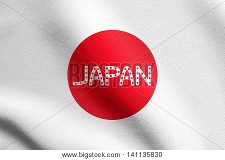 Flag of Japan waving in the wind with detailed fabric texture. Japanese national flag. Word Japan.
