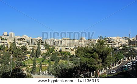 JERUSALEM, ISRAEL, OCTOBER 23, 2013   Panoramic view of the modern city of Jerusalem in Israel next to a park.
