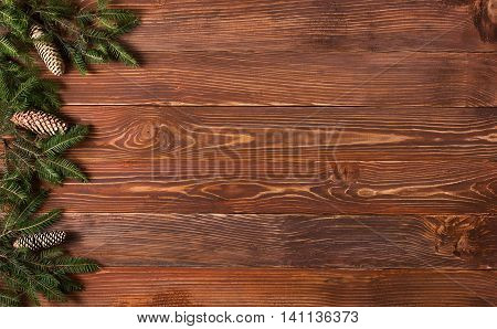 Christmas rustic background - vintage planked wood with lights and free text space.