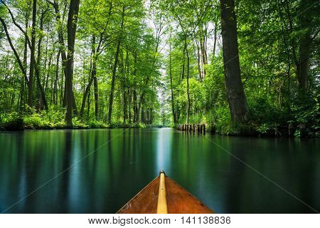 Wooden boat tip on a floating line in the recreation area Spree forest near Berlin
