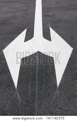 White Traffic Arrow Signage On Road