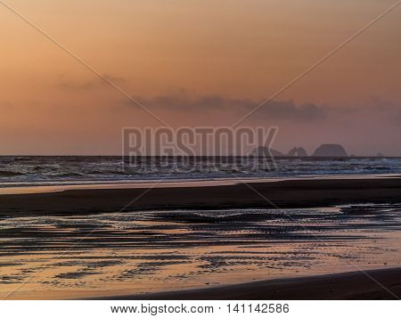 Cape Lookout sunset at low tide Oregon USA
