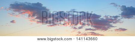panoramic gray clouds, blue and orange sky