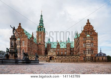 Frederiksborg Castle And Neptune Fountain In Hillerod