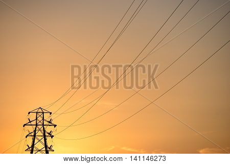 Electricity pylons at sunset energy power lines