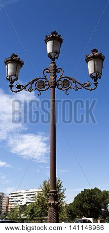 Lamppost of ancient style along many of the old streets of Seville Spain
