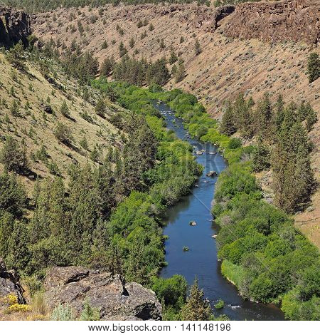 The beautiful blue Deschutes River winds through its canyon in Central Oregon.