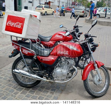 PUERTO VALLARTA MEXICO MAY 07 2016: Coca Cola delevery motorcycle, Coca-Cola (often referred to simply as Coke) is a carbonated soft drink produced by The Coca-Cola Company of Atlanta, Georgia.
