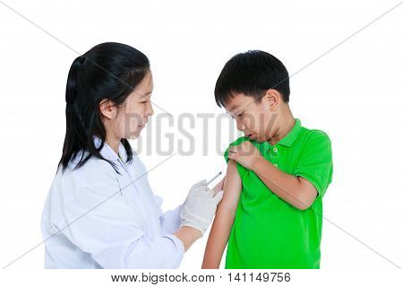 Doctor Vaccinating Boy's Arm. Asian Boy Worry About Vaccine Syringe. Isolated On White Background.