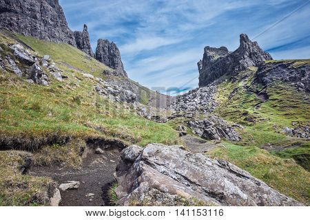 Empty Trekking Path Among Green Slopes of Quiraing in the Isle of Skye