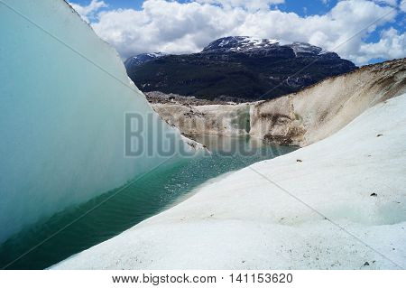 Water in a glaciar with mountains on the background in Patagonia