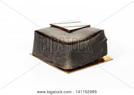 Dark Chocolate cake with golden luster dust on white background