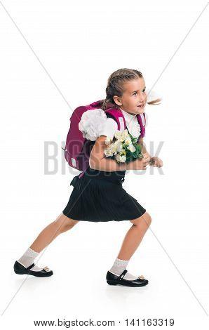 Portrait of schoolgirl with pink satchel. Education and school concept