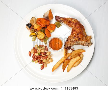 Grilled Chicken Leg with potato wages bean salad grilled vegetable on white background