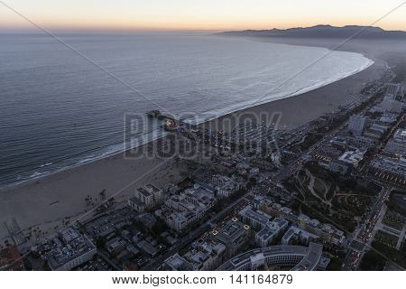 Santa Monica, California, USA - July 21, 2016:  After sunset aerial of Santa Monica beach, pier and ocean.