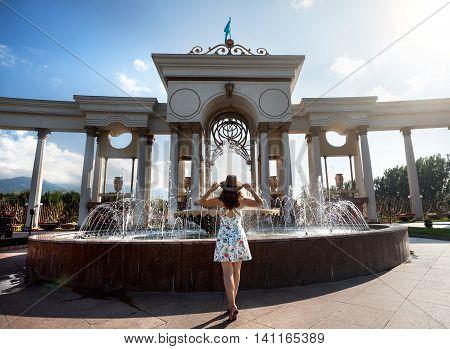 Summertime Girl Near Fountain