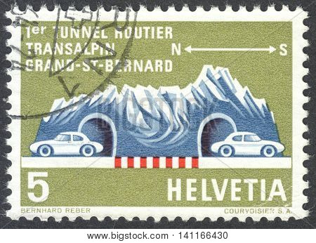 MOSCOW RUSSIA - CIRCA APRIL 2016: a post stamp printed in SWITZERLAND shows mountain massif with a tunnel dedicated to the St. Bernhard Tunnel circa 1964