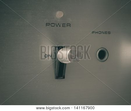 Old power switch button and phone plug of retro audio in vintage effect