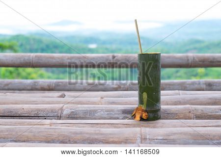 bamboo tube for drinking water on wood bamboo