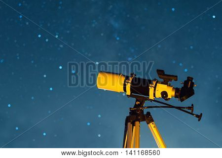 Astronomical Telescope Pointed at the Starry Sky in the Night